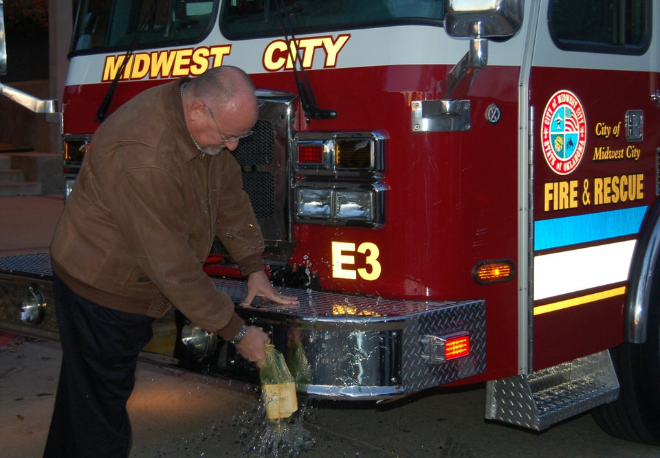 Midwest City Mayor Russell Smith christens new Fire Engine<br/><b>Community Photo By:</b> Kay Hunt<br/><b>Submitted By:</b> Kay, Midwest City