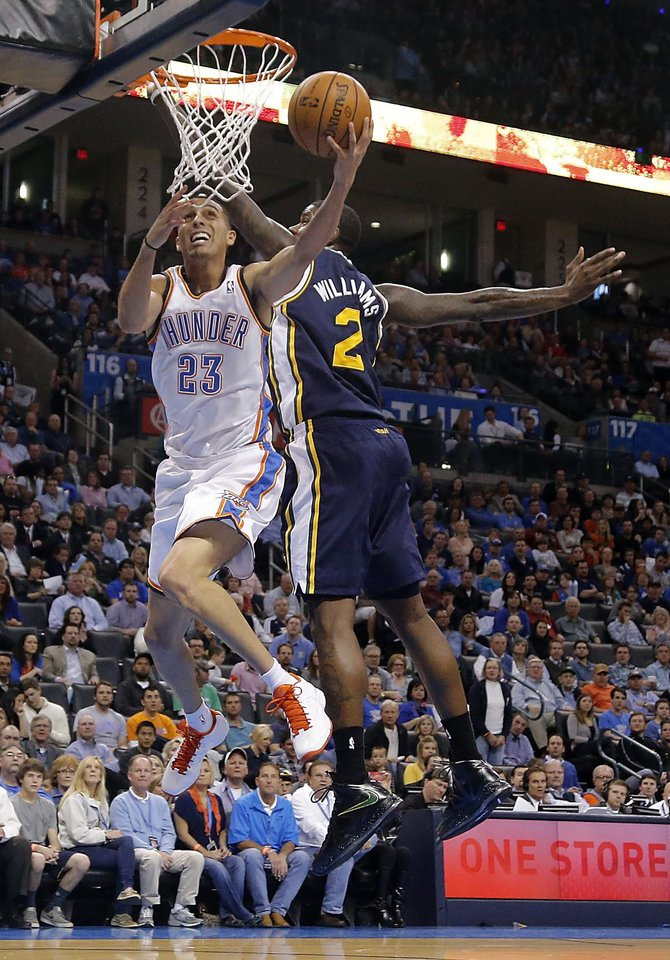 Photo - Oklahoma City Thunder's Kevin Martin (23) drive to the basket past Utah Jazz's Marvin Williams (2) during the NBA basketball game between the Oklahoma City Thunder and the Utah Jazz at Chesapeake Energy Arena on Wednesday, March 13, 2013, in Oklahoma City, Okla. Photo by Chris Landsberger, The Oklahoman