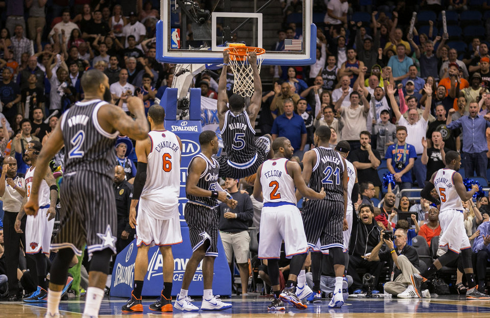 Photo - Orlando Magic's Victor Oladipo (5) dunks during the second overtime of an NBA basketball game against the New York Knicks in Orlando, Fla., Friday, Feb. 21, 2014. The Magic won 129-121. (AP Photo/Willie J. Allen Jr.)