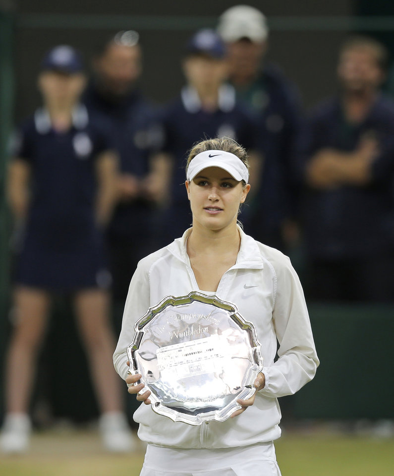 Photo - Eugenie Bouchard of Canada holds her runners-up trophy during the trophy ceremony after losing to Petra Kvitova of the Czech Republic in the women's singles final match at the All England Lawn Tennis Championships in Wimbledon, London, Saturday, July 5, 2014.(AP Photo/Pavel Golovkin)