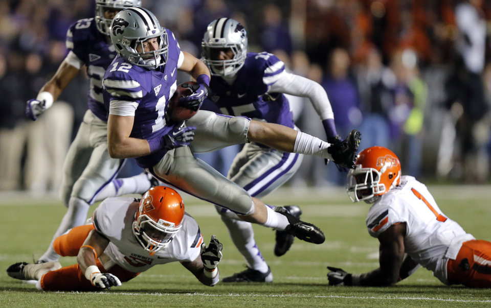 Kansas State\'s Ty Zimmerman (12) is tripped up by Oklahoma State\'s Josh Stewart (5) after a fumble recovery during the college football game between the Oklahoma State University Cowboys (OSU) and the Kansas State University Wildcats (KSU) at Bill Snyder Family Football Stadium on Saturday, Nov. 1, 2012, in Manhattan, Kan. Photo by Chris Landsberger, The Oklahoman