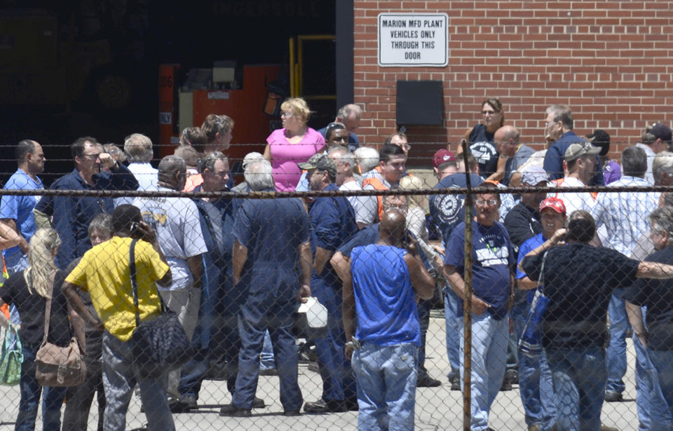 Photo - Employees wait outside after evacuating the GM Marion Metal Center in Marion, Ind., following a chemical explosion Tuesday, July 1, 2014.  One worker died and five more were taken to Marion General Hospital with non-life threatening injuries. (AP Photo/Chronicle-Tribune, Jeff Morehead)