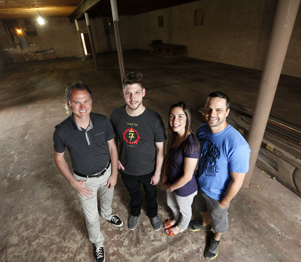 Photo -  From left, developer David Wanzer, Micah Andrews, owner of Oak & Orr, Raena Mutz and Shane Mutz, owners of Roxy's Ice Cream Social, pose for a photo inside 1732 NW 16, the former Blair's Upholstery building in the Plaza District. Photo by Nate Billings, The Oklahoman   NATE BILLINGS -