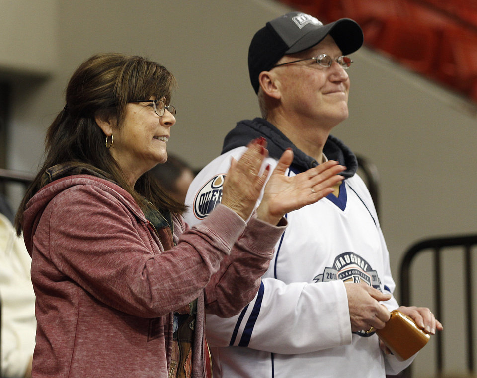 Photo - Madeline and Jim Grace, of Midwest City, celebrate after a goal during a game between the Oklahoma City Barons and the Abbotsford Heat in Oklahoma City, Sunday, Jan. 15, 2012.  Photo by Garett Fisbeck, For The Oklahoman
