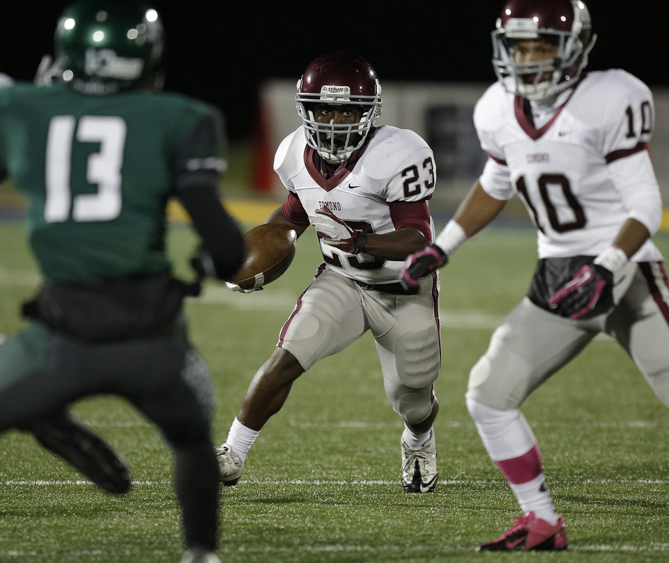 Memorial\'s Waylan Anderson (23) runs the ball during a high school football game between Edmond Memorial and Edmond Santa Fe at Wantland Stadium in Edmond, Okla., Friday, Oct. 26, 2012. Photo by Garett Fisbeck, The Oklahoman