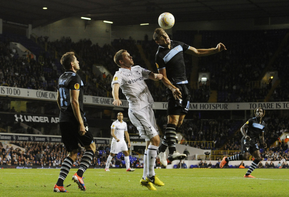 Photo -   Lazio's Miroslav Klose, right, of Germany and Tottenham Hotspur's Gylfi Sigurdsson, center, fight for the ball during a Europa League Group J soccer match at White Hart Lane ground in London, Thursday, Sept. 20, 2012. The match ended 0-0. (AP Photo/Tom Hevezi)