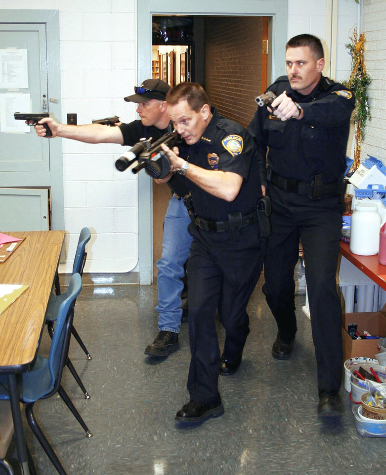 Fairview Police Chief Robert Banks, center, is under investigation by the Oklahoma Council on Law Enforcement Education Training. He is pictured here with Jason Caywood, Major County undersheriff, and Chris Hoffman, Fairview assistant police chief, during a demonstration at Fairview High School. Photo provided