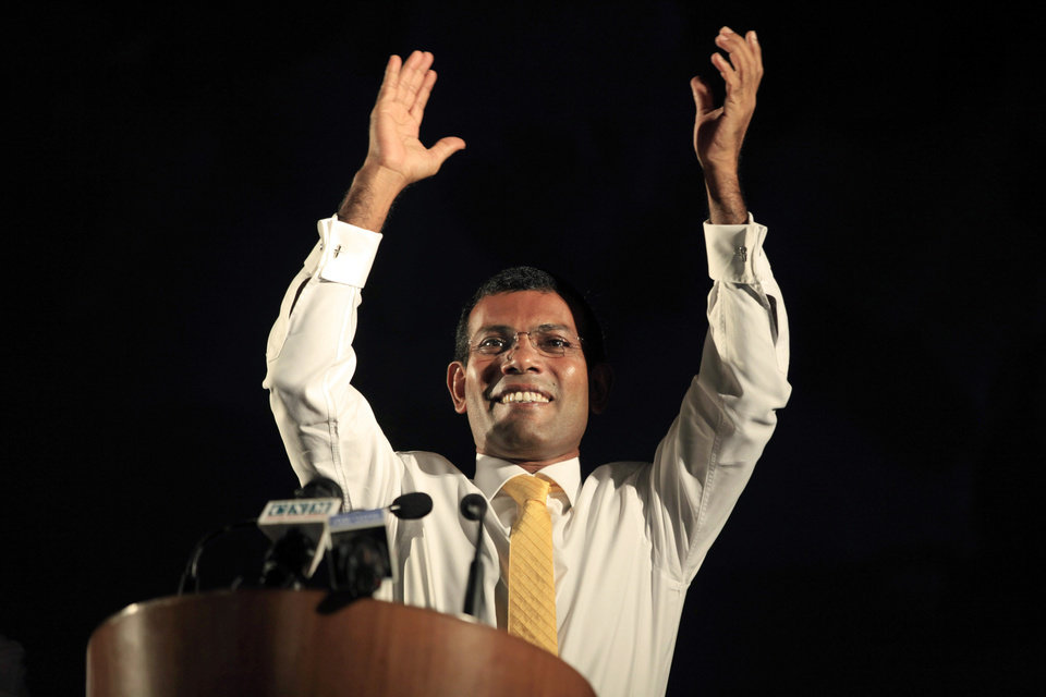 In this Thursday, Sept. 5, 2013 photo, Maldives' former President Mohamed Nasheed waves to the public during a campaign rally ahead of the Sept. 7 presidential elections in Male, Maldives. Nasheed, the first democratically elected president of the Maldives, who was ousted from power last year, said Thursday he will prosecute those behind his removal if he is returned to office in Saturday's election. (AP Photo/Sinan Hussain)