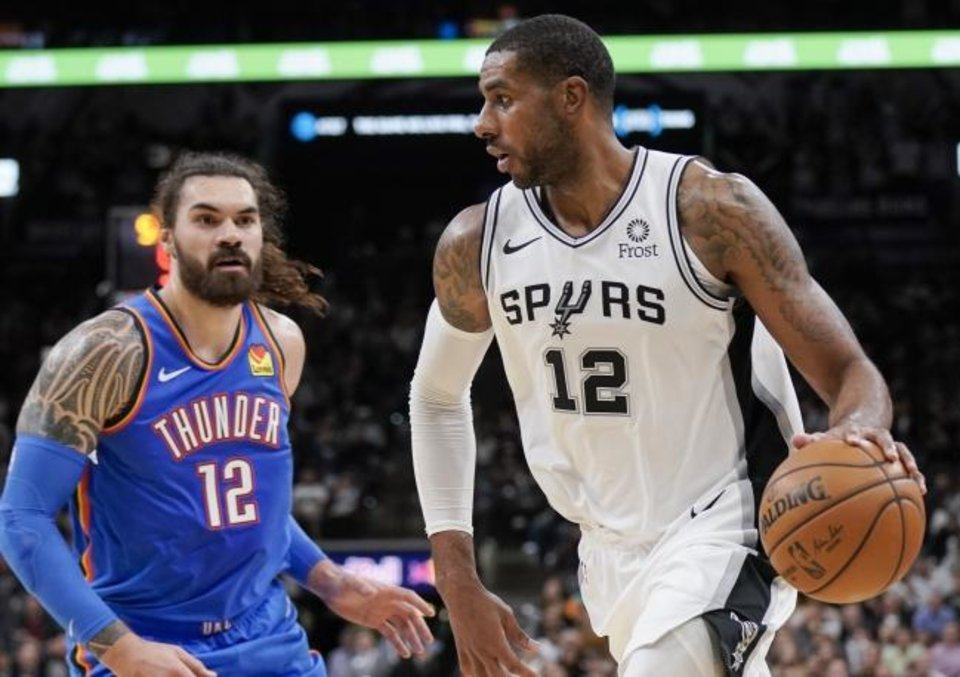 Photo -  San Antonio Spurs' LaMarcus Aldridge, right, drives against Oklahoma City Thunder's Steven Adams during the second half of an NBA basketball game, Thursday, Nov. 7, 2019, in San Antonio. (AP Photo/Darren Abate)