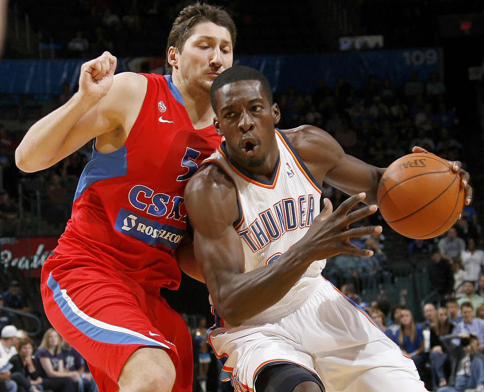 Oklahoma City's Jeff Green (22) drives past CSKA Moscow's Nikita Kurbanov (5) during the preseason NBA basketball game between the Oklahoma City Thunder and CSKA Moscow in Oklahoma City, Thursday, October 14, 2010. Photo by Bryan Terry, The Oklahoman