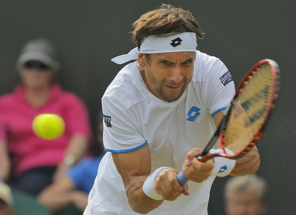 Photo - David Ferrer of Spain plays a return to Andrey Kuznetsov of Russia during their men's singles match at the All England Lawn Tennis Championships in Wimbledon, London, Wednesday, June 25, 2014. (AP Photo/Pavel Golovkin)