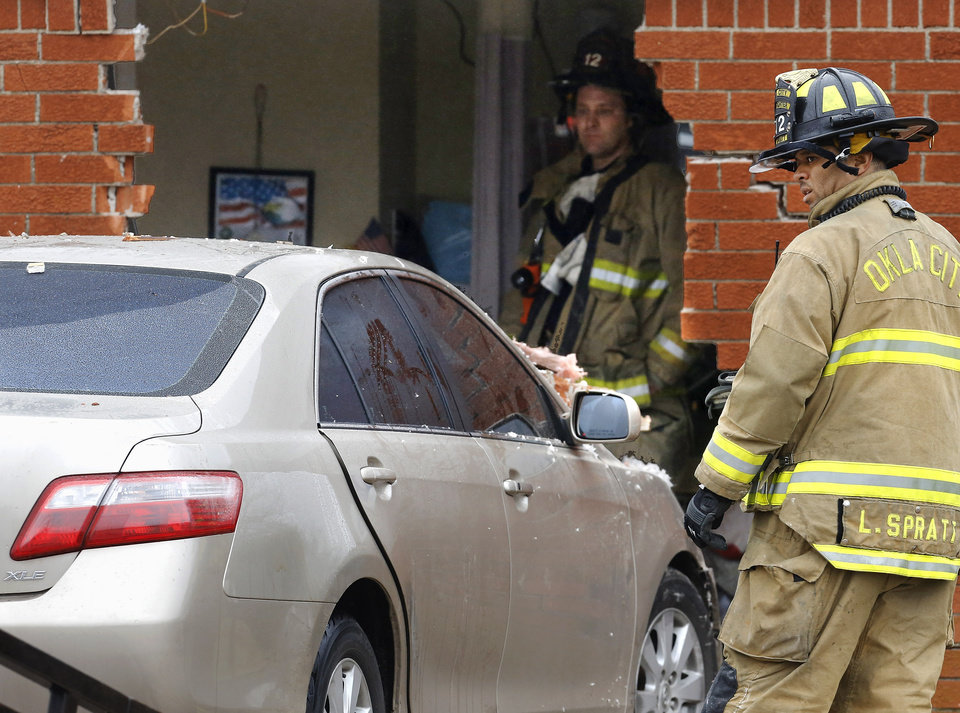 Oklahoma City firefighters look at damage to the north wall of the Skyview Nursing Center after a car drove through the brick exterior and into a resident\'s room on Thursday morning, Jan. 10, 2013. A firefighter at the scene said the car was occupied by a female driver when it plowed into the building at 2200 N. Coltrane. The room was unoccupied at the time of the accident and officials said there were no reported injuries. Photo by Jim Beckel, The Oklahoman