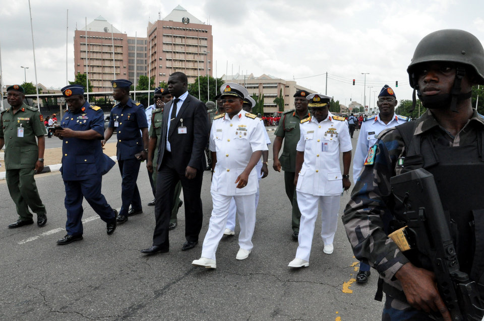 Photo - Nigeria's  chief of defense staff Air Marshal Alex S. Badeh, second from left, and other army chiefs arrive to address the Nigerians Against Terrorism group  during a demonstration calling on the government to rescue the kidnapped girls of the government secondary school in Chibok, in Abuja, Nigeria, Monday, May 26, 2014. Scores of protesters chanting