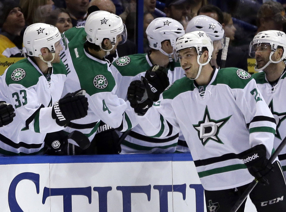 Photo - Dallas Stars' Colton Sceviour right, is congratulated by teammates after scoring during the second period of an NHL hockey game against the St. Louis Blues on Saturday, March 29, 2014, in St. Louis. (AP Photo/Jeff Roberson)