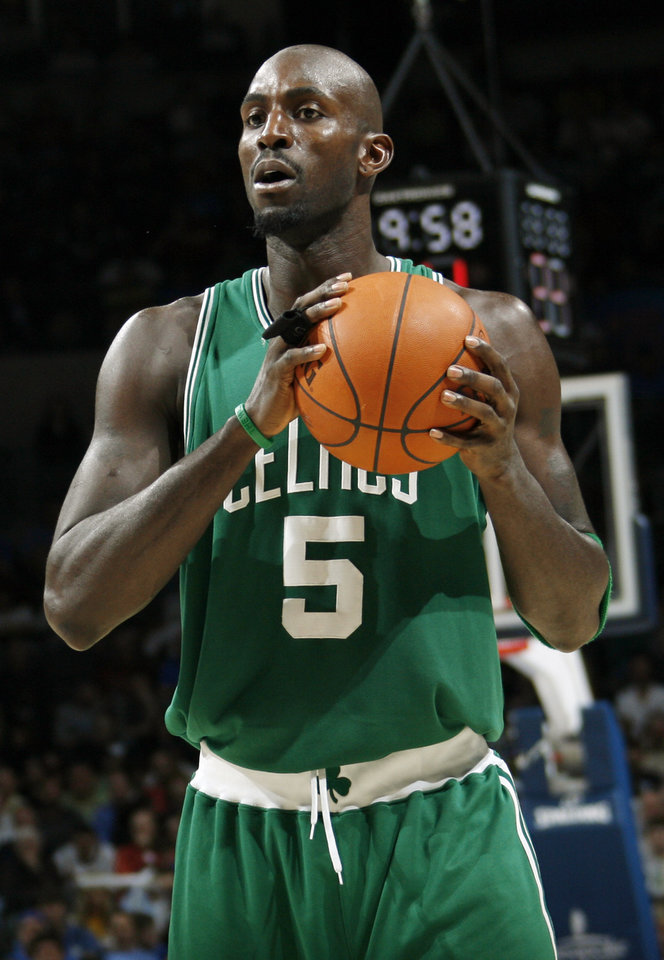 Photo - Boston's Kevin Garnett holds the ball in the second half during the NBA basketball game between the Oklahoma City Thunder and the Boston Celtics at the Ford Center in Oklahoma City, Wednesday, Nov. 5, 2008. Boston won, 96-83. BY NATE BILLINGS, THE OKLAHOMAN ORG XMIT: KOD