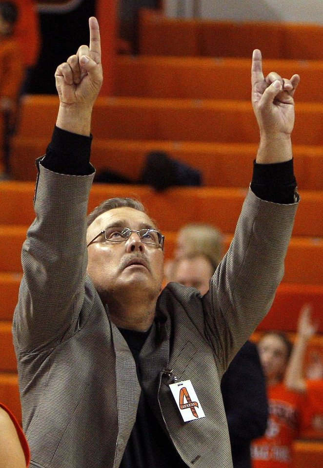 Photo - Oklahoma State interim head coach Jim Littell points to the ceiling following the women's college game between Oklahoma State University and Coppin State at Gallagher-Iba Arena in Stillwater, Okla.,  Saturday, Nov. 26, 2011.  Photo by Sarah Phipps, The Oklahoman