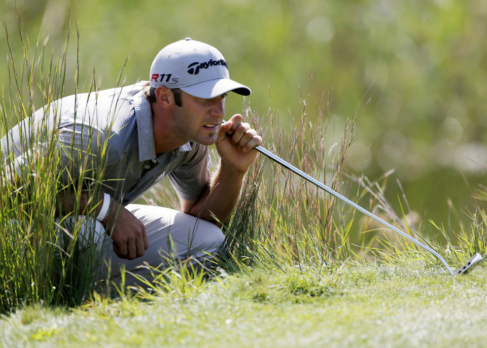Photo -   Dustin Johnson reads the green on the second hole during the final round of the Deutsche Bank Championship PGA golf tournament at TPC Boston in Norton, Mass., Monday, Sept. 3, 2012. (AP Photo/Michael Dwyer)