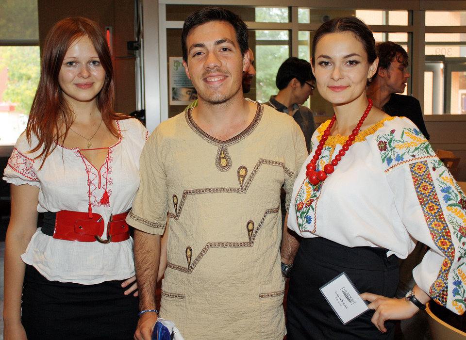 Photo - International Fulbright students attend a cultural dinner at the University of Oklahoma's Couch Cafeteria. From left are Kristina Klykova, Ukraine; Alex Lenferna, South Africa; and Tetiana Bulkh, also from Ukraine, attend the International Fulbright cultural dinner.