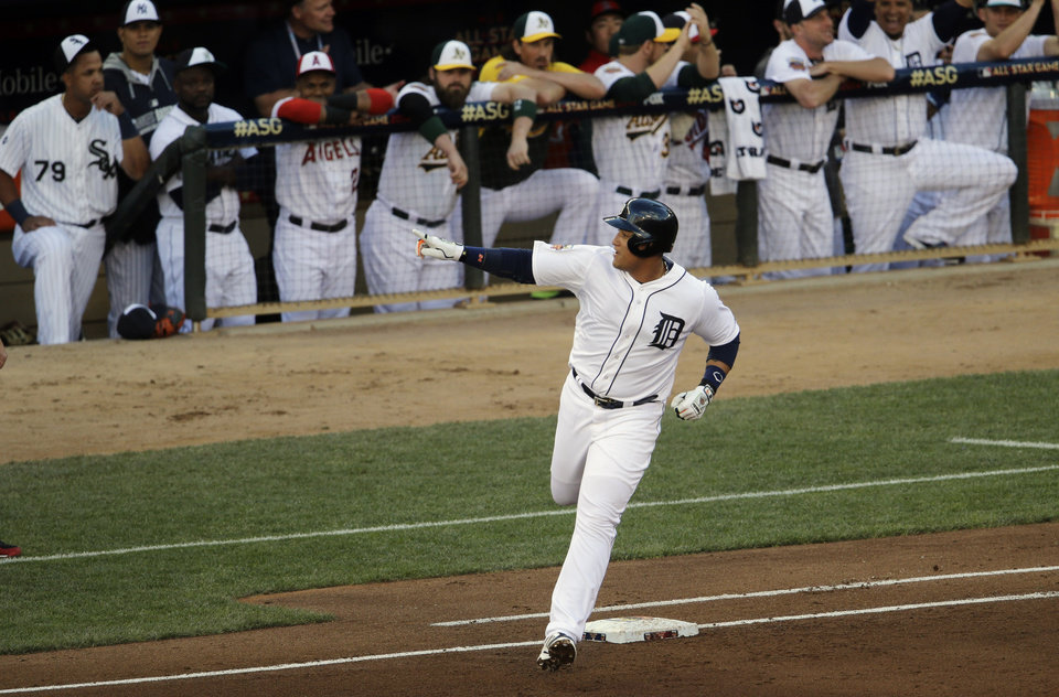 Photo - American League first baseman Miguel Cabrera, of the Detroit Tigers, hits a home run  during the first inning of the MLB All-Star baseball game, Tuesday, July 15, 2014, in Minneapolis. (AP Photo/Paul Sancya)
