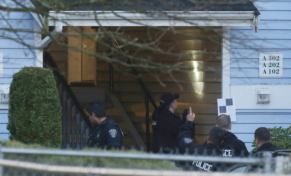 Photo - Investigators examine the stairwell of an apartment complex, Monday, April 22, 2013, in Federal Way, Wash., where an overnight shooting left five people dead., including a suspect who was shot by arriving officers, police said early Monday. (AP Photo/Ted S. Warren)