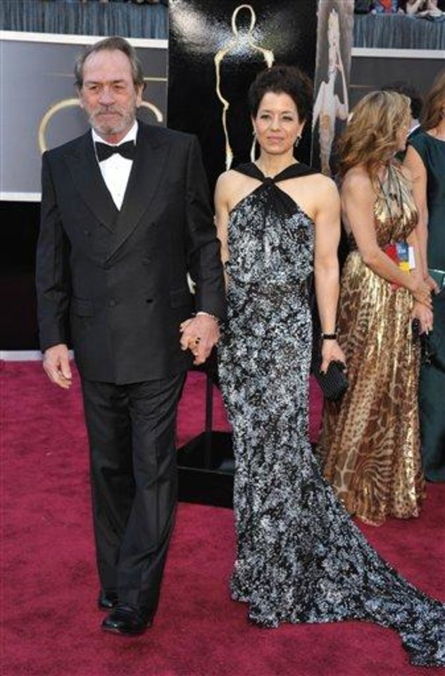 Photo - Actor Tommy Lee Jones and Dawn Jones arrive at the Oscars at the Dolby Theatre on Sunday Feb. 24, 2013, in Los Angeles. (Photo by John Shearer/Invision/AP)