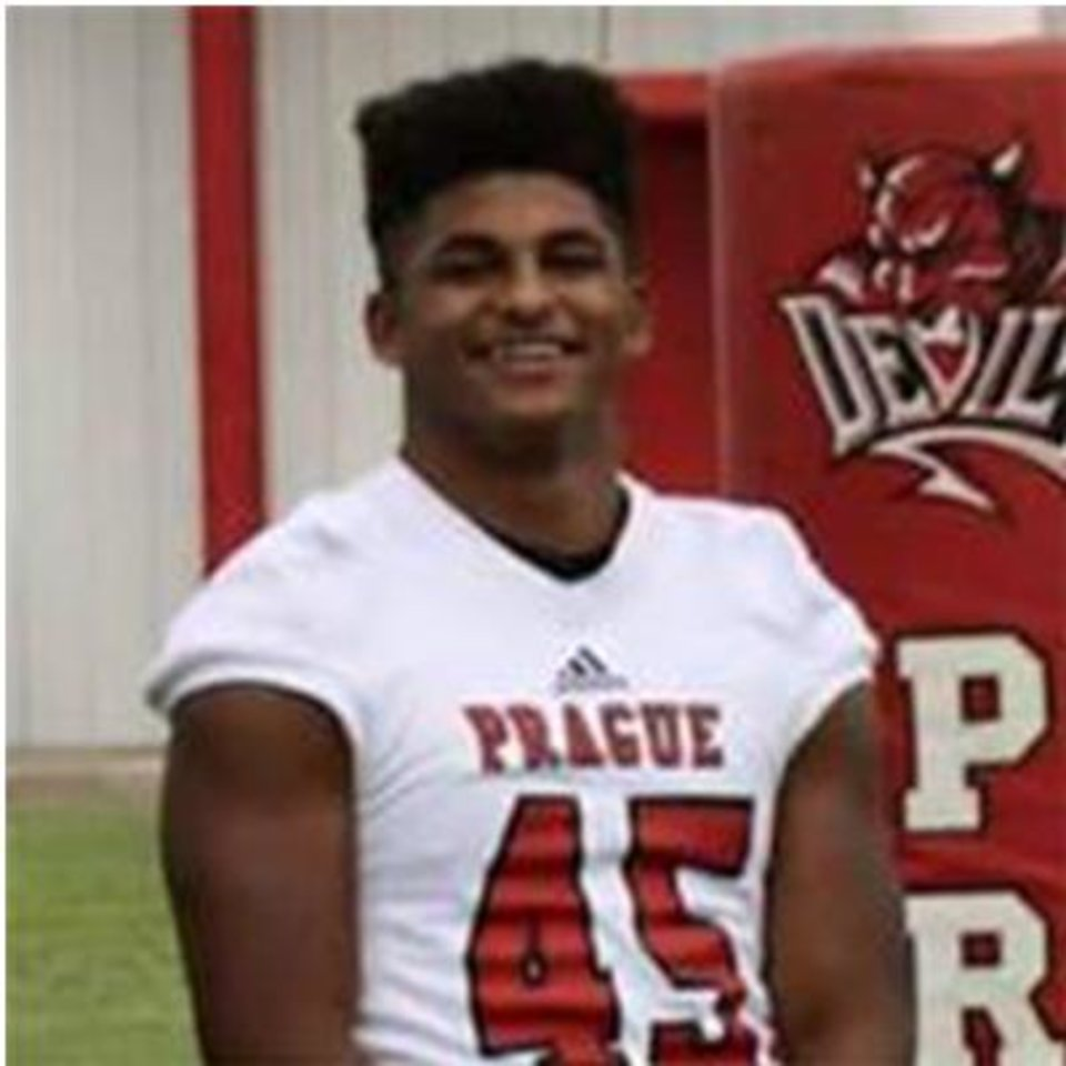 Photo -  Emmanuel Elija Joseph Zenon, 16, in his Prague Red Devils football uniform. Zenon was shot and killed this month in Oklahoma City in what authorities allege was a drug deal gone bad.