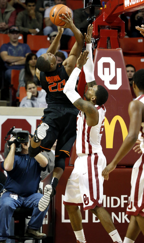 Photo - Cowboy's Markel Brown (22) shoots guarded by Sooner's Steven Pledger (2) during the second half as the University of Oklahoma Sooners (OU) defeat  the Oklahoma State Cowboys (OSU) 77-68  in NCAA, men's college basketball at The Lloyd Noble Center on Saturday, Jan. 12, 2013  in Norman, Okla. Photo by Steve Sisney, The Oklahoman