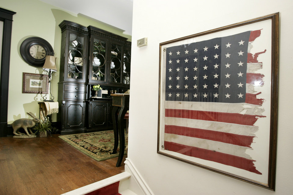 Photo - INTERIOR: Remnants of an American flag burned in front of the house by the Ku Klux Klan in 1923 hangs at the top of the stairs of the 2009 Symphony Designers Show House at 431 NW 17 in Oklahoma City, Oklahoma, Thursday, April 16, 2009.  Photo by Steve Gooch, The Oklahoman ORG XMIT: KOD
