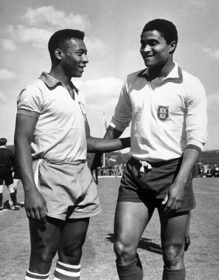 Photo - FILE - In this April 27, 1963 file photo, Brazilian footballer Edson Arantes do Nascimento, known as Pele, left, enjoys a chat with Eusebio da Silva Ferreira in Lisbon, Portugal. Eusebio, the Portuguese football star who was born into poverty in Africa but became an international sporting icon and was voted one of the 10 best players of all time, has died of heart failure aged 71, Sunday, Jan. 5 2014. (AP Photo, File)