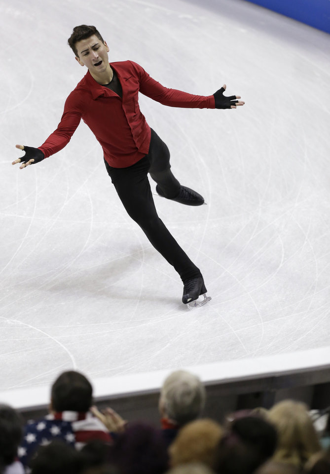Max Aaron competes in the senior men's free skate program at the U.S. figure skating championships in Omaha, Neb., Sunday, Jan. 27, 2013. (AP Photo/Nati Harnik)