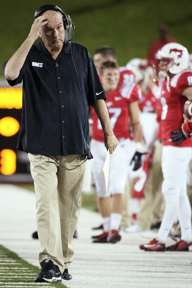 Photo -   SMU head coach June Jones paces the sidelines during the second quarter of an NCAA college football game against Houston, Thursday, Oct. 18, 2012, in Dallas. (AP Photo/Houston Chronicle, Smiley N. Pool) MANDATORY CREDIT