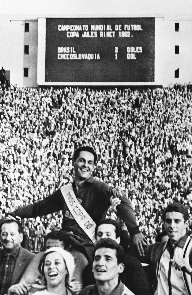 Photo - FILE - In this June 17, 1962 file photo, Brazil's goalkeeper Gilmar is held aloft by supporters, after Brazil defeated Czechoslovakia in the World Cup final soccer match, in Santiago, Chile. On this day: Brazil defeated Czechoslovakia three goals to one to defend the trophy it had won four years earlier in Sweden. (AP Photo/File)