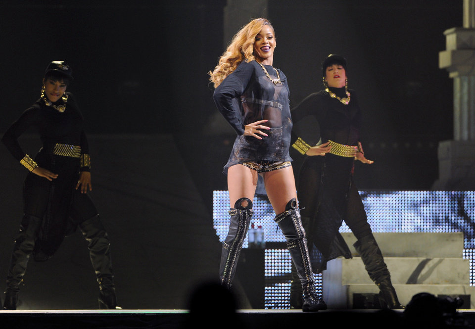 Photo -  Singer Rihanna performs at the Barclays Center on Tuesday, May 7, 2013 in New York. (Photo by Evan Agostini/Invision/AP) ORG XMIT: NYEA101