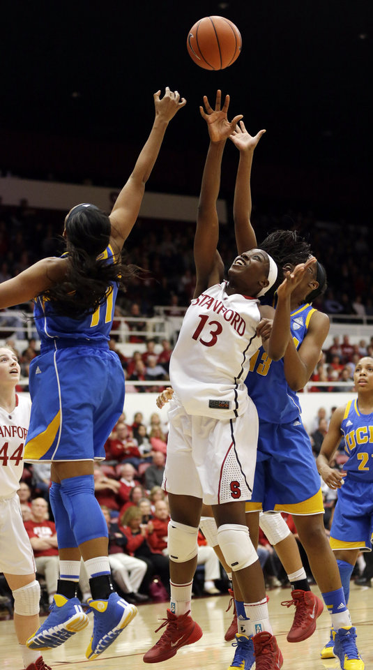 Photo - Stanford 's Chiney Ogwumike (13) reaches for a rebound against UCLA's Atonye Nyingifa, left, during the first half of an NCAA college basketball game on Friday, Jan. 24, 2014, in Stanford, Calif. (AP Photo/Marcio Jose Sanchez)