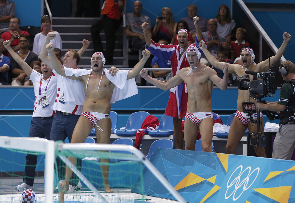 Members of the Croatian men's water polo team celebrate after defeating Italy in the men's water polo gold medal match at the 2012 Summer Olympics, Sunday, Aug. 12, 2012, in London. (AP Photo/Alastair Grant)