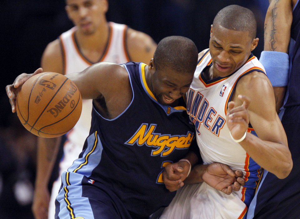 Photo - Oklahoma City's Russell Westbrook (0) defends against Denver's Raymond Felton (20) during the NBA basketball game between the Denver Nuggets and the Oklahoma City Thunder in the first round of the NBA playoffs at the Oklahoma City Arena, Wednesday, April 27, 2011. Photo by Sarah Phipps, The Oklahoman