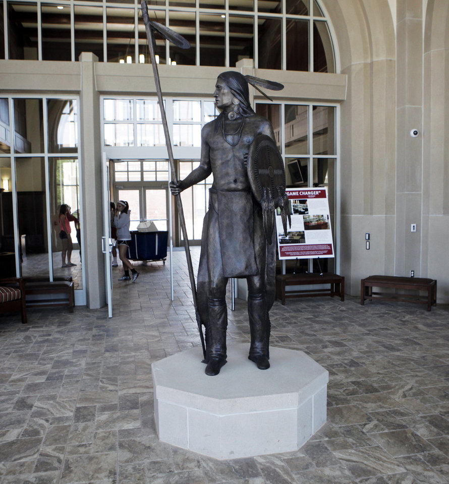 An indian statue stands in the entrance to the ground floor of the newly constructed Headington Hall, a $75 million privately funded student housing facility for student athletes on the campus of the University of Oklahoma on July 28, 2013. Photo by KT KING, The Oklahoman
