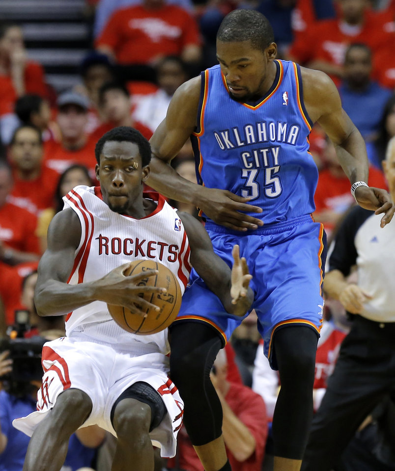 Oklahoma City\'s Kevin Durant guards Houston\'s Patrick Beverley during Game 4 in the first round of the NBA playoffs between the Oklahoma City Thunder and the Houston Rockets at the Toyota Center in Houston, Texas, Monday, April 29, 2013. Photo by Bryan Terry, The Oklahoman