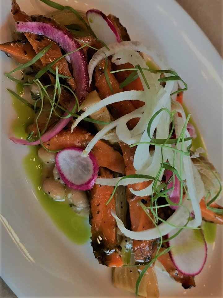 Photo - Charred carrot salad from Patrono in downtown Oklahoma City. [Dave Cathey/The Oklahoman]