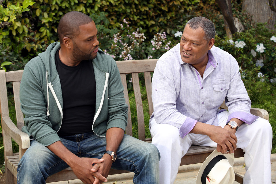 Photo - This image released by ABC shows Anthony Anderson, left, and Laurence Fishburne in a scene from the comedy