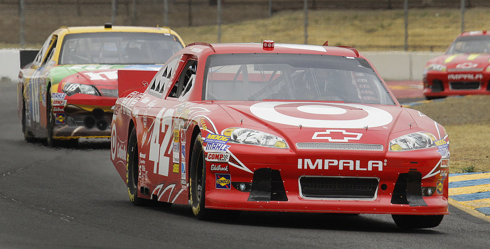 Photo -   Driver Juan Pablo Montoya, of Colombia, leads Denny Hamlin during practice for Sunday's NASCAR Sprint Cup Series auto race Friday, June 22, 2012, in Sonoma, Calif. (AP Photo/Ben Margot)