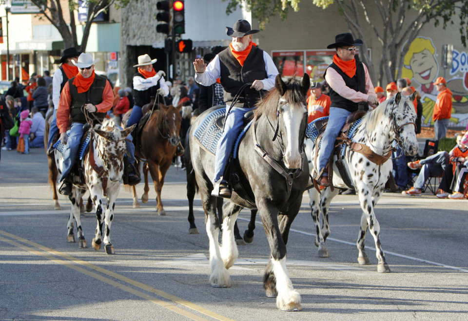 Photo - Horses and riders participate in the Oklahoma State Cowboy's homecoming parade in downtown Stillwater, OK, Saturday, Oct. 29, 2011. By Paul Hellstern, The Oklahoman