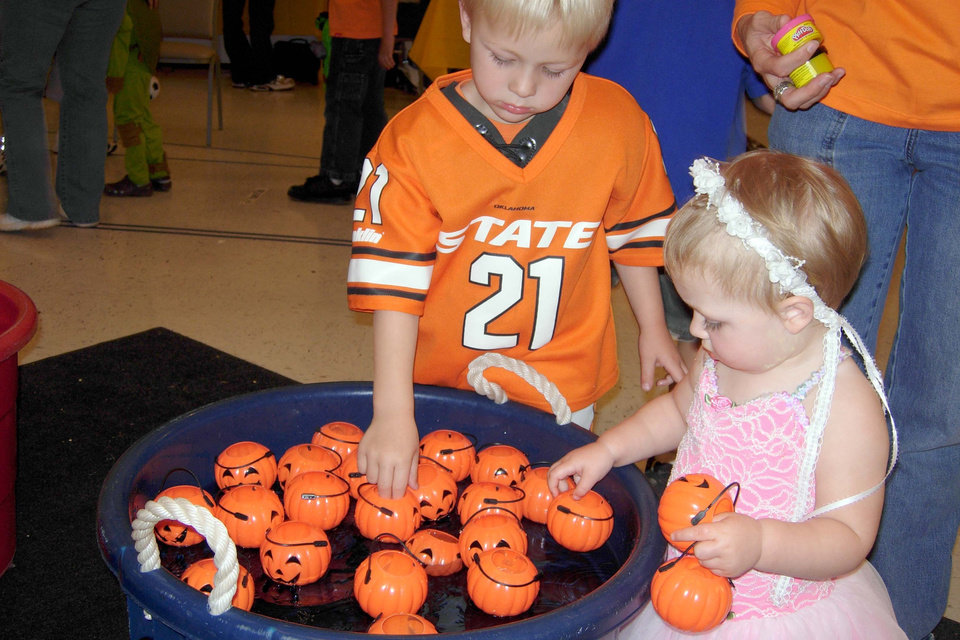 """Jake and Kendal Carey play the """"Pick-A-Pumpkin"""" game at the Family Fall Festival and Trunk or Treat event at First Christian Church in Guthrie on Sunday, Oct. 28. Community Photo By: Karen Allen Submitted By: Karen,"""