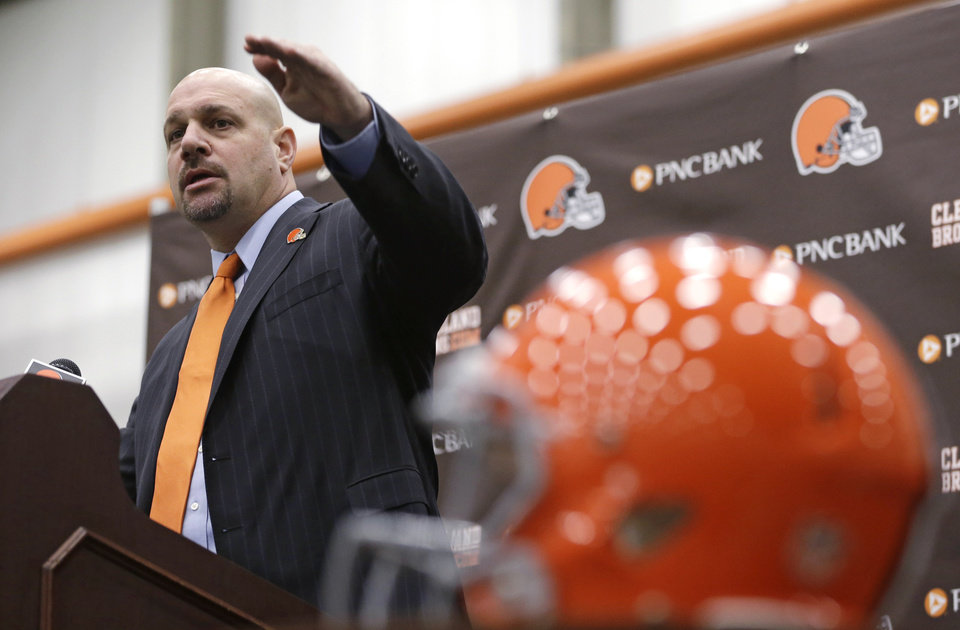 Photo - Cleveland Browns coach Mike Pettine speaks during a news conference Thursday, Jan. 23, 2014, in Berea, Ohio. Buffalo's defensive coordinator, who met with team officials for the first time just a week ago, finalized a contract Thursday to become the Browns' seventh full-time coach since 1999. (AP Photo/Tony Dejak)