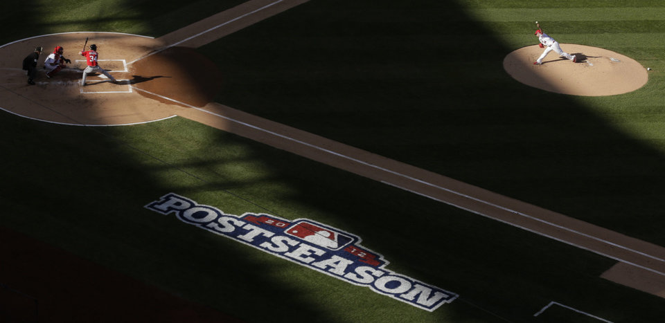 Photo -   St. Louis Cardinals starting pitcher Christian Garcia, right, throws to Washington Nationals' Bryce Harper during the first inning of Game 2 of the National League division baseball series, Monday, Oct. 8, 2012, in St. Louis. (AP Photo/Charlie Riedel)