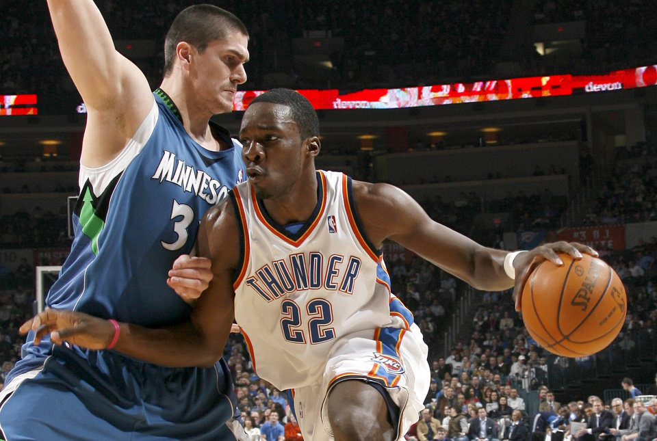 Photo - Oklahoma City's Jeff Green drives around Minnesota's Darko Milicic during the NBA basketball game between the Oklahoma City Thunder and the Minnesota Timberwolves, at the Ford Center in Oklahoma City, Friday, Feb. 26, 2010.  Photo by Bryan Terry, The Oklahoman ORG XMIT: KOD