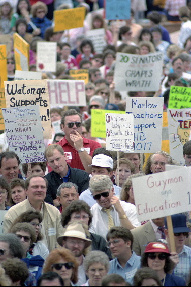 20th ANNIVERSARY OF HB-1017. A sea of signs carried by teachers and other protesters filled the grounds at the at the state Capitol. April 16, 1990. Staff Photo by Jim Beckel.