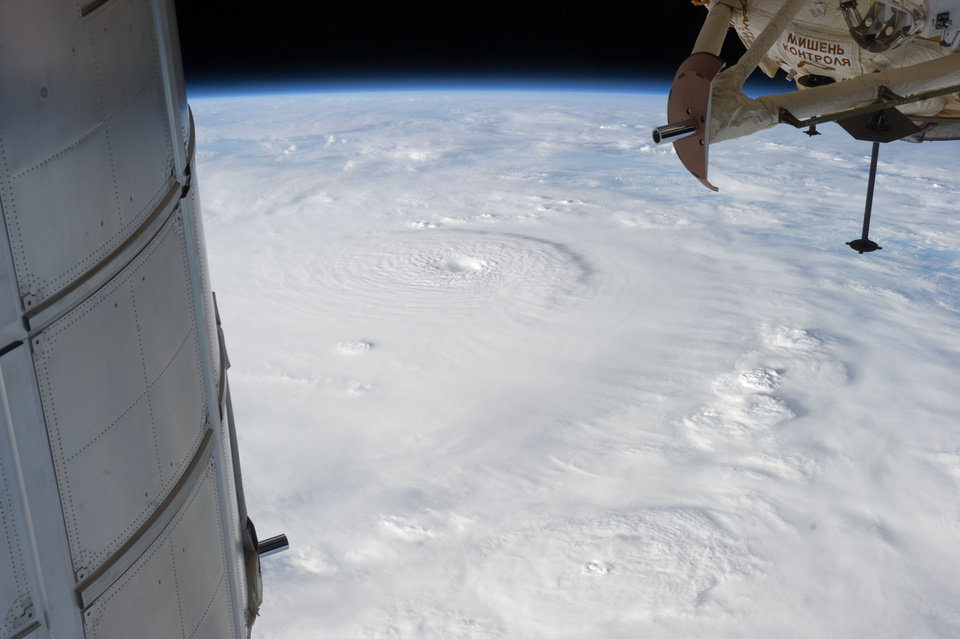 Photo - This photo provided by NASA and made from the International Space Station on Dec. 2, 2012, shows Typhoon Bopha moving toward the Philippines. Typhoon Bopha slammed into the Davao region of the Philippines early Tuesday, Dec. 4, killing at least seven people and forcing more than 50,000 to flee from inundated villages. (AP Photo/NASA)