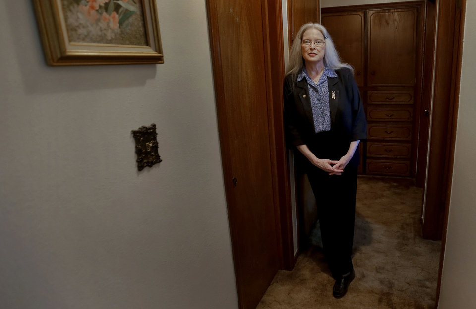 Nikki Winters stands in the hallway of her south Oklahoma City home Wednesday. Four strangers joined her and her son underneath a matress in the hallway as a tornadio struck nearby May 31.  <strong>CHRIS LANDSBERGER - CHRIS LANDSBERGER</strong>