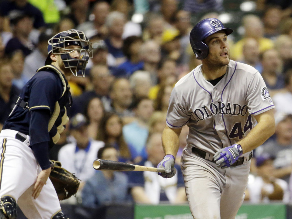 Photo - Milwaukee Brewers catcher Jonathan Lucroy watches as Colorado Rockies' Ryan Wheeler hits a grand slam during the fourth inning of a baseball game Thursday, June 26, 2014, in Milwaukee. (AP Photo/Morry Gash)